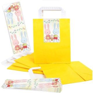 Gelbe Ostertüten mit Henkel + Osterhasen Aufkleber in rosa blau